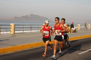 marathon runners ocean view