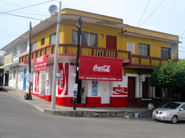 "Quince Letras, corner of Tampico and Francisco Villas streets We load from either side of this ""Coca Cola"" store on the corner"