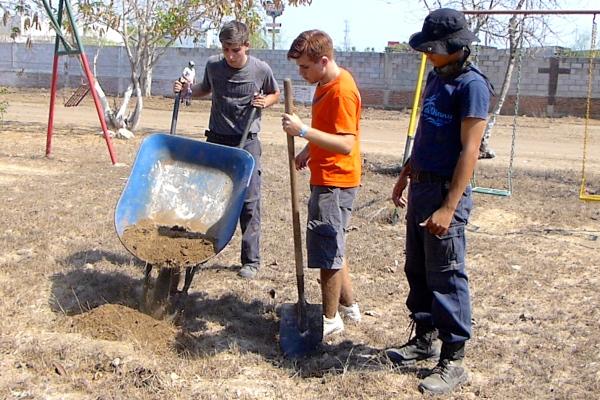 Wheelbarrow and shovelers