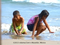 Kids playing in the surf