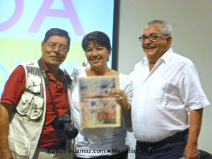Sandra and Hector, center and right, with their first issue