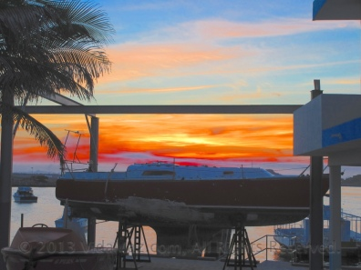 Sunrise over a drydocked boat