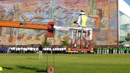 View of part of the group, the mural, and the cherry picker