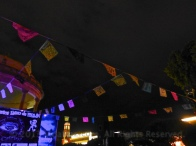 Papel picado hanging over the stage