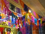 The papel picado hanging above the Monumental Altar