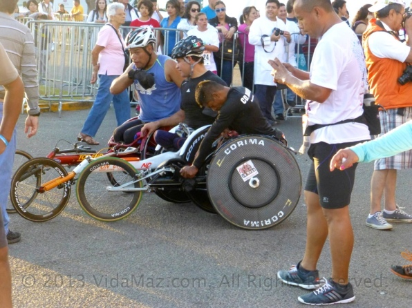 Competitors in wheelchairs after the race