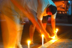 Father and son placing their candles
