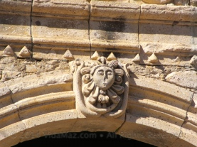 Over the side door of the church