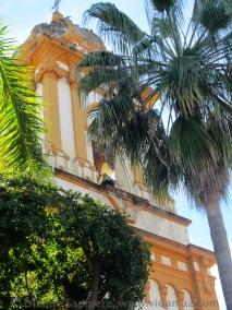 Church through palm trees