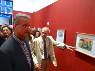 The Maestro guides the Mayor through the exhibit