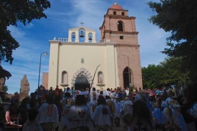 The church in Mochicahui with a crowd gathering