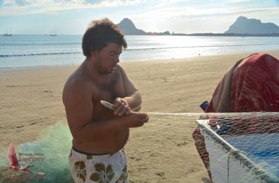 Fishermen repairing their nets
