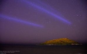 Laser lights over Deer Island