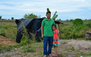 Yes, this father and daughter live in that house of poles with plastic covering...