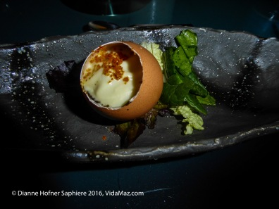 1. Free welcome course: Shrimp in eggshell with squid ink and lobster reduction, micro-greens.