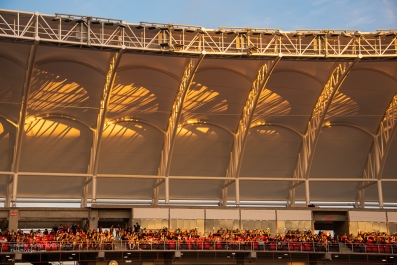 Sunset colors and reflections on the new stadium roof